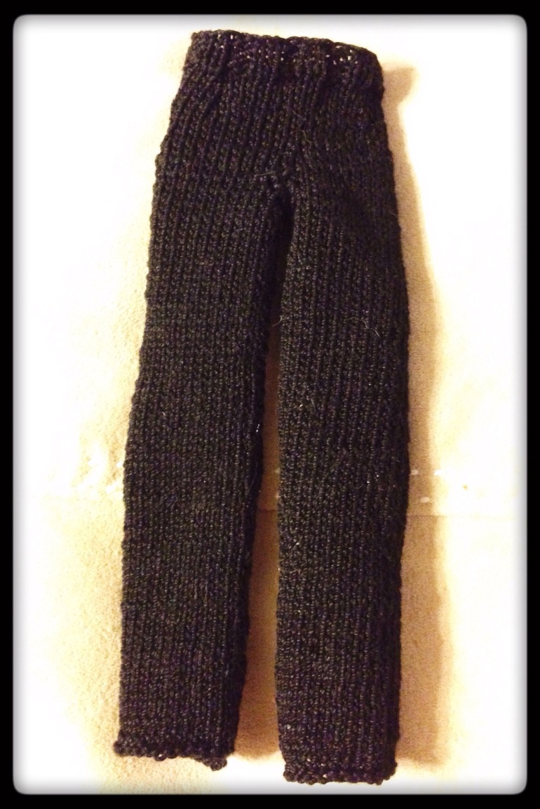 A black pair of straight-leg pants designed for a belly-button type Barbie doll.