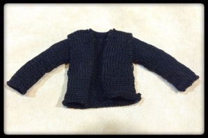 A knit jacket made for an Ood doll